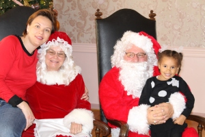 Marina and Sasha with Mr. & Mrs. Clause